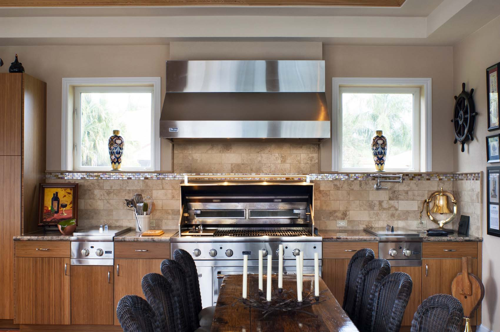 Custom designed outdoor kitchen with high end, commercial grade appliances and grill.